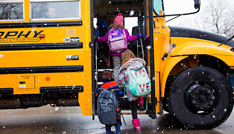 St.-Boniface922-students-getting-on-school-bus